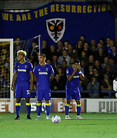 (From L-R) AFC Wimbledon's Lyle Taylor, Cody McDonald and Andy Barchan line up for the free kick during the Sky Bet League 1 match between AFC Wimbledon and MK Dons at the Cherry Red Records Stadium, Kingston, England on 22 September 2017. Photo by Carlton Myrie / PRiME Media Images.