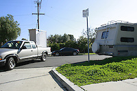 A RV parked near the intersection of an alley and Everts Street in Pacific Beach, blocks visibilty for cars entering and exiting the alley Friday, February 1 2008.  San Diego City Council are studying the cost of toughening regulations for  overnight parking of RVs in coastal neighborhoods.
