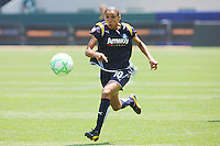 Marta #10 of the Los Angeles Sol attacks the defense during their WPS match against the Boston Breakers at Home Depot Center on May 10, 2009 in Carson, California.