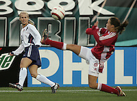 06 November,  2004.  USWNT defender Heather Mitts (2) crosses the ball past Denmark's Bettina Falk (5)  at  Lincoln Financial Field in Philadelphia, Pa.