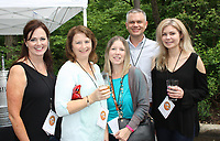 NWA Democrat-Gazette/CARIN SCHOPPMEYER Colleen Hendren (from left), Tracy Hodge, Lisa Heilman, Ross Carver and Kim McKay enjoy Gardens on Tap on May 20 at Compton Gardens and Conference Center in Bentonville.