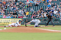 AFL East first baseman Peter Alonso (20), of the Scottsdale Scorpions and New York Mets organization, prepares to apply the tag to Keston Hiura (23) on a pick-off attempt as first base umpire Nestor Ceja looks on during the Arizona Fall League Fall Stars game at Surprise Stadium on November 3, 2018 in Surprise, Arizona. The AFL West defeated the AFL East 7-6 . (Zachary Lucy/Four Seam Images)