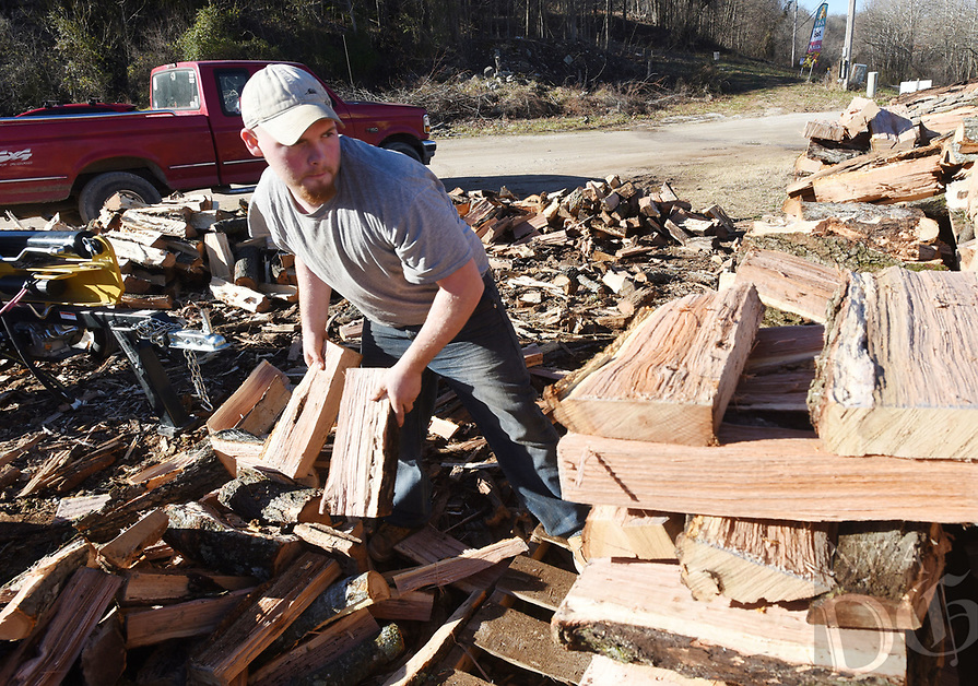 NWA Democrat-Gazette/FLIP PUTTHOFF <br /> WOOD FOR THE WINTER<br /> Brian Krantz stacks oak firewood on Tuesday Jan. 8 2019 east of Rogers near Beaver Lake. Krantz and B.J. Burns sell firewood to customers near the lake.