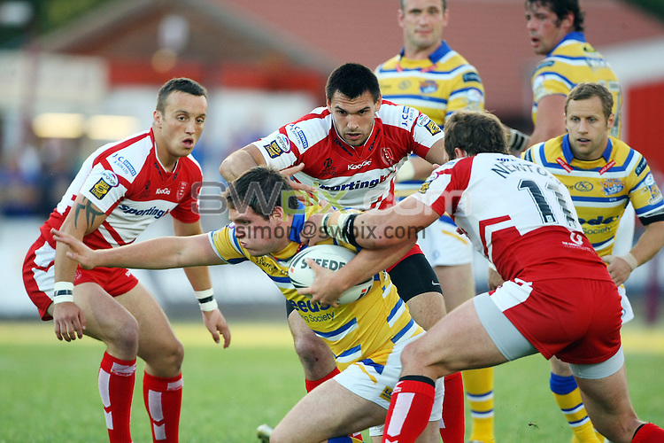 PICTURE BY VAUGHN RIDLEY/SWPIX.COM - Rugby League - Super League - Hull KR v Leeds - Craven Park, Hull, England - 09/07/10...Copyright - Simon Wilkinson - 07811267706...Hull KR's Josh Hodgson, Matt Cook and Clint Newton keep their eyes on Leeds Luke Ambler.
