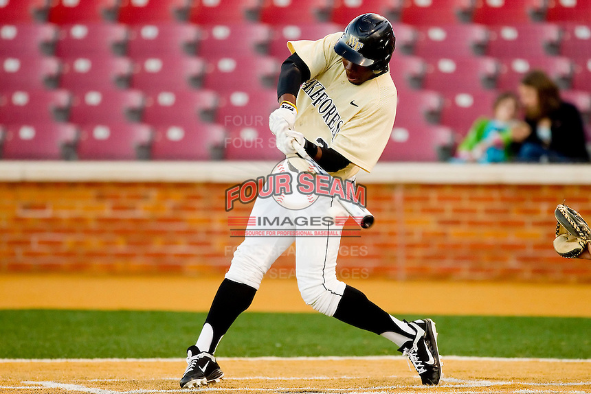 Kevin Jordan #21 of the Wake Forest Demon Deacons connects for a pinch-hit RBI single against the Georgetown Hoyas at Wake Forest Baseball Park on February 26, 2012 in Winston-Salem, North Carolina.  (Brian Westerholt / Four Seam Images)
