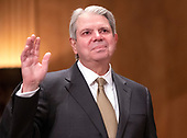 """Eugene L. Dodaro, Comptroller General of the United States, US Government Accountability Office, is sworn-in prior to their giving testimony before the United States Senate Committee on Homeland Security & Governmental Affairs during a hearing entitled """"Examining CMS's Efforts to Fight Medicaid Fraud and Overpayments"""" on Capitol Hill in Washington, DC on Tuesday, August 21, 2018.<br /> Credit: Ron Sachs / CNP"""