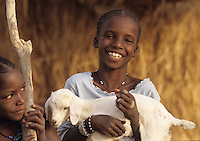 Fulani girl with sheep