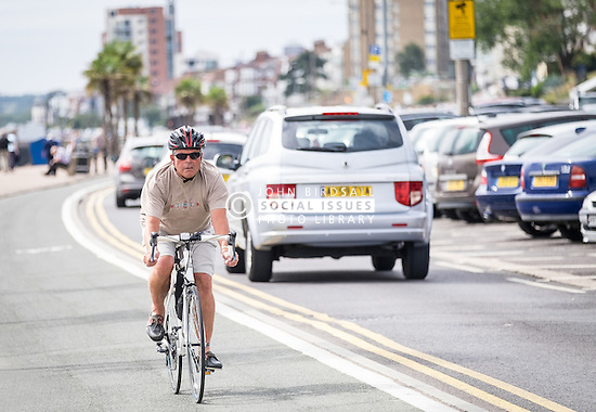 A cyclist using the cycle lane on Southend seafront in Essex.