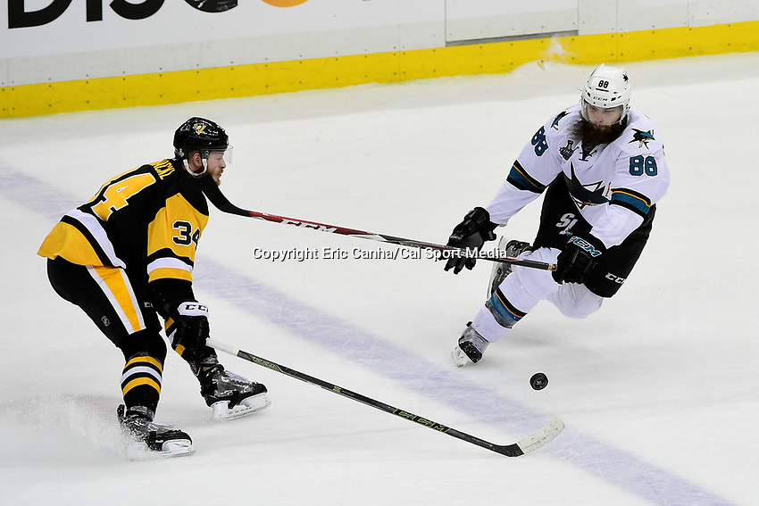 Wednesday, June 1, 2016: Pittsburgh Penguins right wing Tom Kuhnhackl (34) gets hit in the face by San Jose Sharks defenseman Brent Burns (88) during game 2 of the NHL Stanley Cup Finals  between the San Jose Sharks and the Pittsburgh Penguins held at the CONSOL Energy Center in Pittsburgh Pennsylvania. The Penguins beat the Sharks in overtime 2-1 and lead the best of 7 series 2-0. Eric Canha/CSM