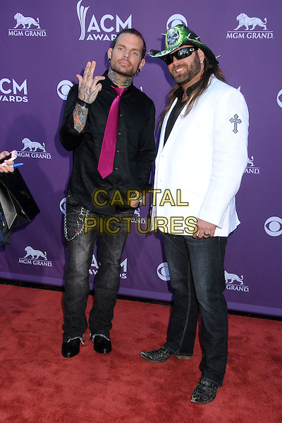 Jeff Hardy, James Storm.47th Annual Academy of Country Music Awards held at the MGM Grand, Las Vegas, Nevada, USA..April 1st, 2012.full length white jacket jeans denim pink tie hand tattoos hat black sunglasses shades CMA ACM.CAP/ADM/BP.©Byron Purvis/AdMedia/Capital Pictures.