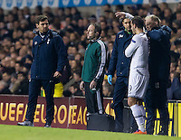 12.12.2013 London, England. A concerned Tottenham Hotspur manager André Villas Boas looks on as Tottenham Hotspur forward Roberto Soldado (9) receives treatment on the touchline during the Europa League game between Tottenham Hotspur and Anzhi Makhachkala from White Hart Lane.
