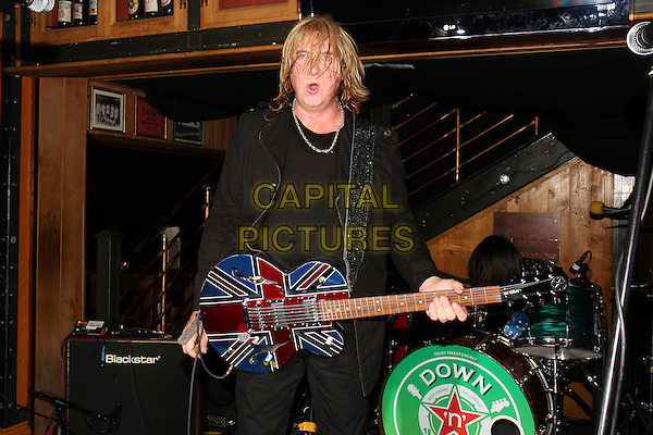 JOE ELLIOTT.Joe Elliott of Def Leppard launches a new beer, Down 'n' Outz, and performs with his side project band of the same name, Porterhouse, London, England..September 21st, 2010.stage concert live gig performance music half length guitar black jacket mouth open.CAP/MAR.© Martin Harris/Capital Pictures.