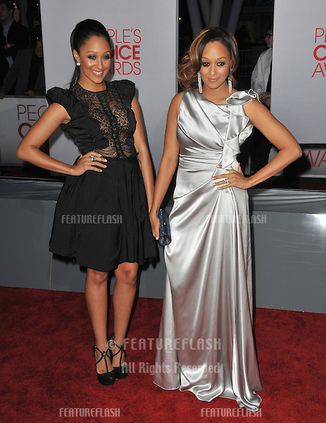 Tia Mowry & Tamera Mowry at the 2012 People's Choice Awards at the Nokia Theatre L.A. Live..January 11, 2012  Los Angeles, CA.Picture: Paul Smith / Featureflash