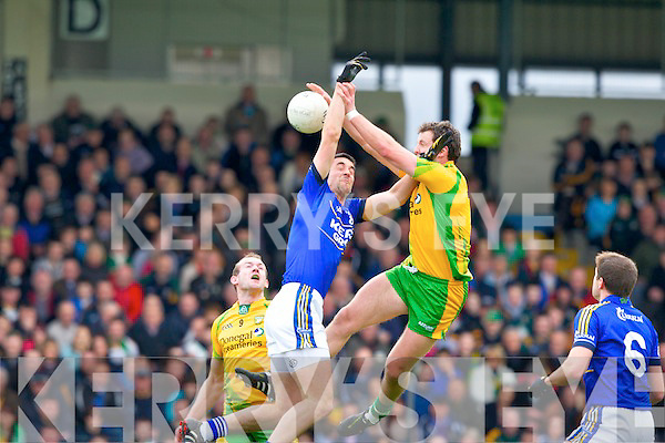 Donegal's Michael Murphy breaks the ball ahead of Kerry's Anthony Maher during their Allianz National football league clash in Fitzgerald Stadium on Sunday