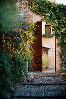 Entrance to the courtyard of 'I Cerri', 14th century Watch-tower of the Poreta Castle in Spoleto, Umbria, Italy