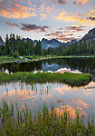 Wind River Range, WY: A colorful sunset and reflections from Horseshoe Lake with Cirque of the Towers in the distance; Lizard Head Meadows; Popo Agie Wilderness in the Bridger National Forest in summer