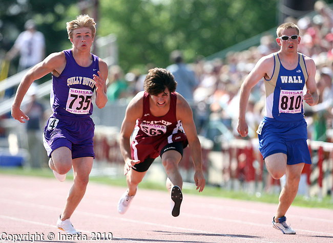 SIOUX FALLS, SD - MAY 29:  Herman Kleinsasser of Sully-Buttes leads Brad Tunge of Marion as he stumbles and Kyle Harris of Wall in the Boys Class B 100 meter dash Finals at the 2010 South Dakota State Track Meet. (Photo by Dave Eggen/Inertia)