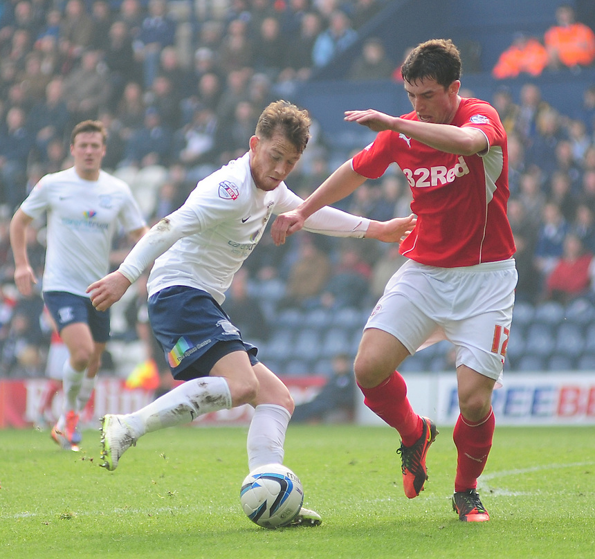 Preston North End's Joe Garner vies for possession with Crawley Town's Joe Walsh <br /> <br /> Photo by Chris Vaughan/CameraSport<br /> <br /> Football - The Football League Sky Bet League One - Preston North End v Crawley Town - Saturday 29th March 2014 - Deepdale - Preston<br /> <br /> &copy; CameraSport - 43 Linden Ave. Countesthorpe. Leicester. England. LE8 5PG - Tel: +44 (0) 116 277 4147 - admin@camerasport.com - www.camerasport.com