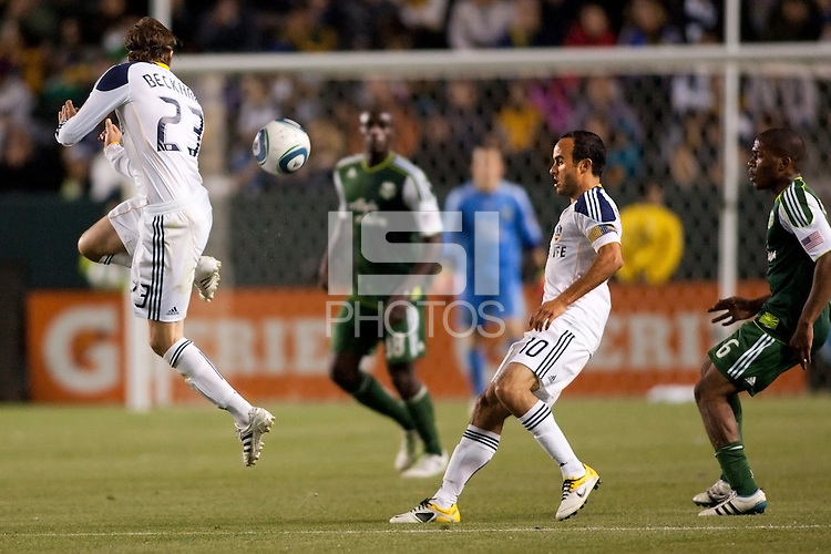 LA Galaxy midfielder David Beckham (23) back heals a ball to team mate Landon Donovan (10). The LA Galaxy defeated the Portland Timbers 3-0 at Home Depot Center stadium in Carson, California on  April  23, 2011....