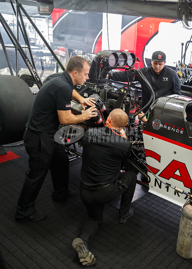 Feb 10, 2017; Pomona, CA, USA; Crew members with NHRA top fuel driver Steve Torrence during qualifying for the Winternationals at Auto Club Raceway at Pomona. Mandatory Credit: Mark J. Rebilas-USA TODAY Sports