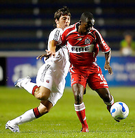 DC United defender Facundo Erpen (5) prepares to tackle the ball away from Chicago Fire midfielder Thiago (10).  The Chicago Fire defeated the DC United 3-0 in the semifinals of the U.S. Open Cup at Toyota Park in Bridgeview, IL on September 6, 2006...