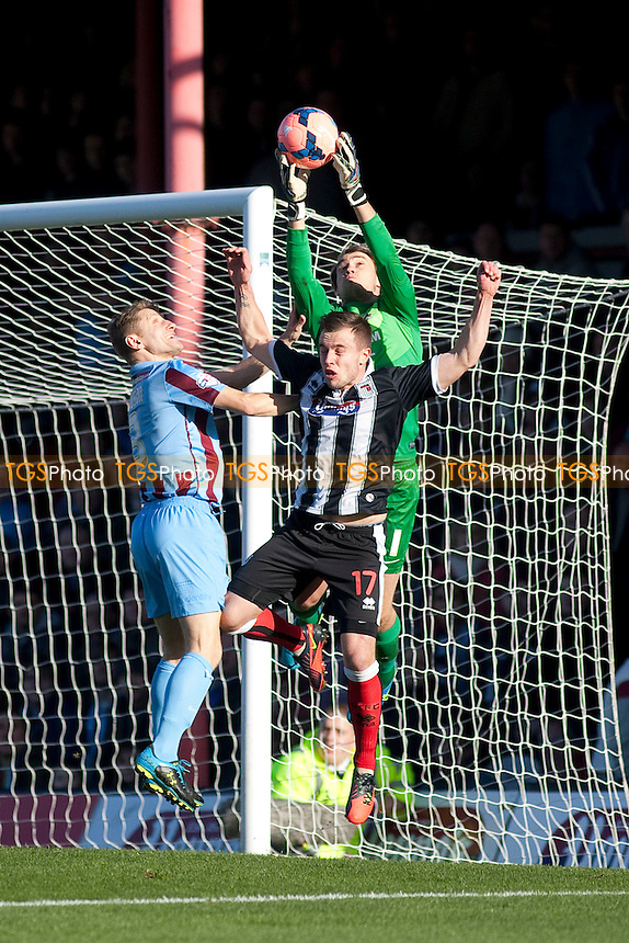 Sam Slocombe of Scunthorpe U collects under pressure<br />  - Grimsby Town vs Scunthorpe United - FA Cup 1st Round Football at Blundell Park, Grimsby, Lincolnshire - 09/11/13 - MANDATORY CREDIT: Mark Hodsman/TGSPHOTO - Self billing applies where appropriate - 0845 094 6026 - contact@tgsphoto.co.uk - NO UNPAID USE