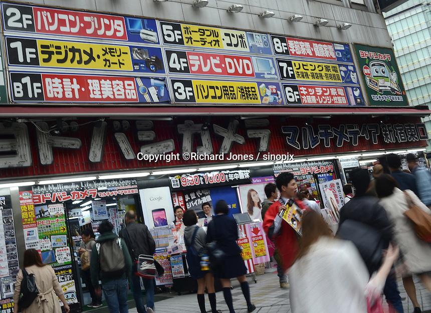 Yodobashi Camera, big electric and multi media shop sells camera, camcorder, computer, printer, TV, DVD and watch by JR Shinjuku station, Tokyo