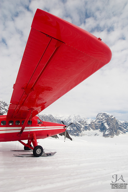 Side View of a DeHavilland Turbine Otter Skiplane in Alaska, on Ruth Glacier near Mt McKinley