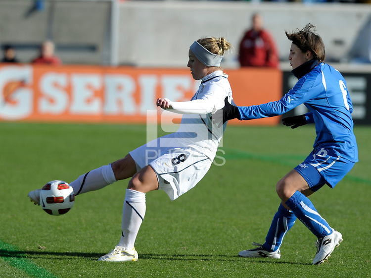 US forward Amy Rodriguez (8) plays the ball while being defended by Italian defender Laura Neboli (6).  The U.S. Women's National Team defeated Italy 1-0 at Toyota Park in Bridgeview, IL on November 27, 2010 to advance to the Women's World Cup in Germany.