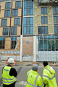 Construction workers on site at Camden Council's new Swiss Cottage Community Centre, London.