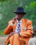 Legendary blues piano man Pinetop Perkins enjoys a cigarette before he plays at the Annual Robert Johnson memorial concert in Mississippi. Photo©Suzi Altman