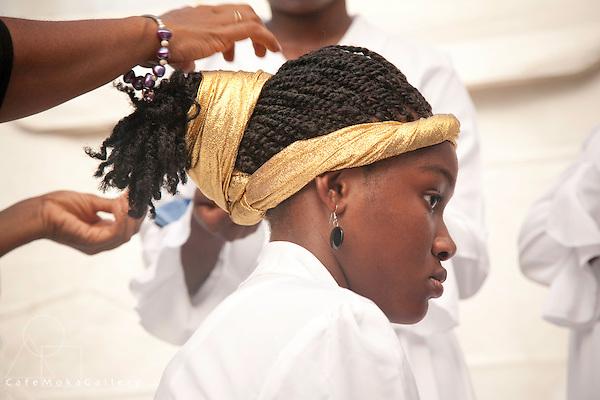 Tobago Heritage Festival, Black Rock,female dancer backstage having a headress woven into her hair