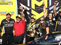 Jul 24, 2016; Morrison, CO, USA; Mike Green (left) crew chief for NHRA top fuel driver Tony Schumacher (center) with team owner Don Schumacher and daughter Megan Schumacher during the Mile High Nationals at Bandimere Speedway. Mandatory Credit: Mark J. Rebilas-USA TODAY Sports