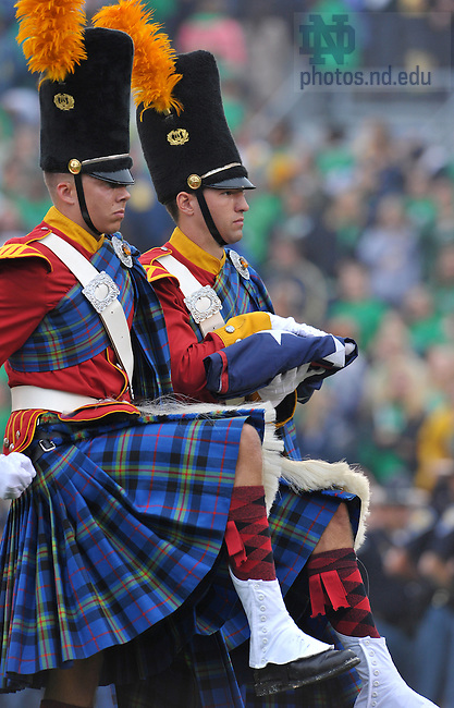 The Irish Guard take the U.S. flag to the flagpole before the start of the football game against Michigan, Sept. 11, 2010...Photo by Matt Cashore/University of Notre Dame