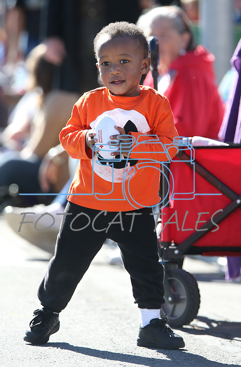 Camden Wilson, 2, watches the Nevada Day parade in Carson City, Nev., on Saturday, Oct. 31, 2015. <br /> Photo by Cathleen Allison