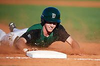 Dartmouth Big Green catcher Bennett McCaskill (18) slides safely into third base during a game against the Northeastern Huskies on March 3, 2018 at North Charlotte Regional Park in Port Charlotte, Florida.  Northeastern defeated Dartmouth 10-8.  (Mike Janes/Four Seam Images)