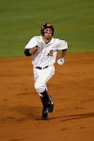 Jared McDonald of the Arizona State Sun Devils hits an inside the park homerun against the Oral Roberts Eagles in the Tempe Regionals at Packard Stadium, Tempe, AZ - 05/30/2009.Photo by:  Bill Mitchell/Four Seam Images