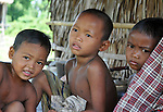 Children of family in agriculture that was affected severely by drought weather sit outside their poorly constructed house with natural material in a village near Siem Reap. The family in agriculture industry was affected severely by drought weather.