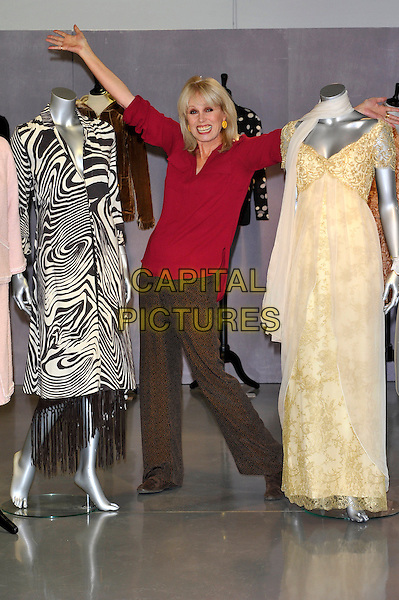 Joanna Lumley.Photocall to promote auction of her clothing worn in various TV programs, held at Kerry Taylor Auctions, Long Lane, Borough, London, England..November 12th, 2012.full length red top brown trousers mannequins hands arms black white gold dress zebra animal print .CAP/CJ.©Chris Joseph/Capital Pictures.