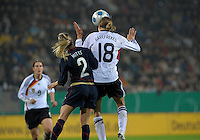 Kerstin Garefrekes heads he ball over Heather Mitts. US Women's National Team defeated Germany 1-0 at Impuls Arena in Augsburg, Germany on October 29, 2009.