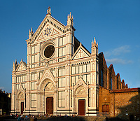 Oblique view of the facade,  Basilica di Santa Croce, (Basilica of the Holy Cross), 1294, Florence, Tuscany, Italy, pictured on June 8, 2007, in the afternoon. The Basilica di Santa Croce is the main Franciscan church in Florence. It was consecrated in 1442 and is located on the Piazza Santa Croce. Filled with  magnificent art, it houses the tombs of many famous Italians, including Michelangelo, Galileo, Machiavelli and Rossini. The neo-Gothic marble facade, 1857-63, was designed by Nicolo Matas. Florence, capital of Tuscany, is world famous for its Renaissance art and architecture. Its historical centre was declared a UNESCO World Heritage Site in 1982. Picture by Manuel Cohen.