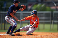 Houston Astros Aaron Mizell (55) slides into second as Luke Dykstra (18) swipes the tag during an instructional league game against the Atlanta Braves on October 1, 2015 at the Osceola County Complex in Kissimmee, Florida.  (Mike Janes/Four Seam Images)