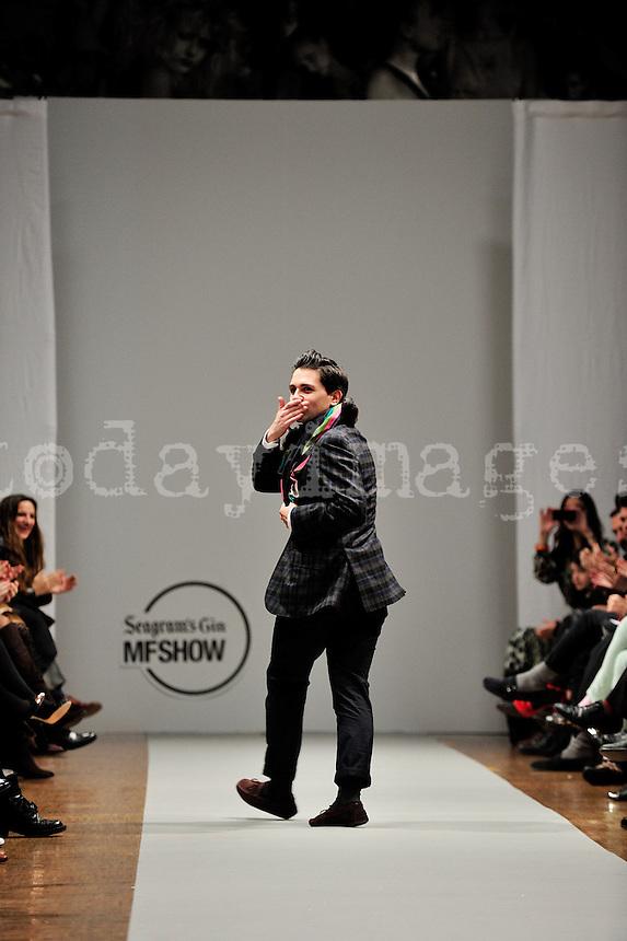 Spanish fashion designer Jorge Acuña greeting on the runway
