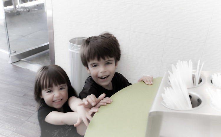 Brother and Sister having fun together at an ice cream counter