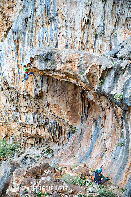 Climbing a project route at Elona, Leonidio, Greece. Leonidio is a relatively new climbing area with huge potential as a winter sport climbing destination.
