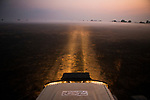 Panthera research vehicle on mist-covered floodplain at sunrise, Busanga Plains, Kafue National Park, Zambia