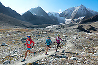 Trail running on the Via Valais, a multi-day trail running tour connecting Verbier with Zermatt, Switzerland. In the background is the Mont Blanc de Cheilon.