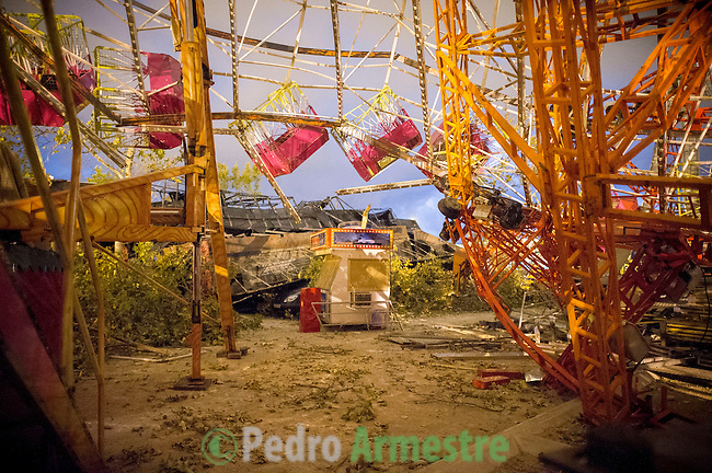 A man is seen between them destruction of the fair of Gandia, near Valencia after storms of the past night, on September 29, 2012.  At least eight people, including a young girl and an elderly woman, have died in Spain as a result of floods brought on by downpours, regional officials said. Four people died in the Andalusia region, including a woman in her 80s, a couple found in their car and a man who died of a heart attack. Some 500 people remained evacuated from their homes in the area early on Saturday after the torrential rains caused rivers to break their banks and flooded roads and railways, regional authorities said. (c) Pedro ARMESTRE
