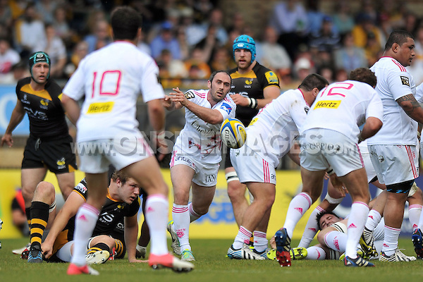 Julien Dupuy passes the ball. European Champions Cup play-off, between London Wasps and Stade Francais on May 18, 2014 at Adams Park in High Wycombe, England. Photo by: Patrick Khachfe / JMP
