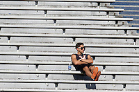 A lone students watches from the empty stands during the Virginia football game Saturday Oct. 5, 2013 at Scott Stadium in Charlottesville, VA. Ball State defeated Virginia 48-27. Photo/The Daily Progress/Andrew Shurtleff